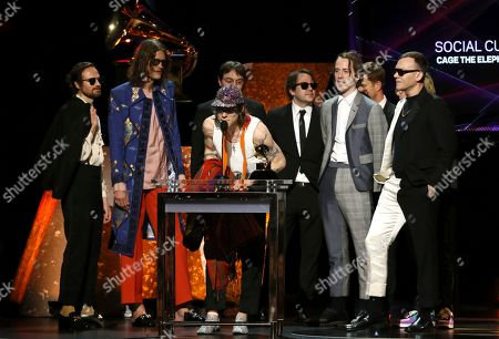 """Stock Image of Matt Shultz, center, of Cage the Elephant, accepts the award for best rock album for """"Social Cues"""" at the 62nd annual Grammy Awards, in Los Angeles"""