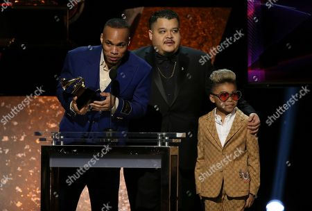 """Anderson .Paak, Jhair Lazo, Soul Rasheed. Anderson .Paak, far left, accepts the award for best R&B performance for """"Come Home"""" with Jhair Lazo and Soul Rasheed at the 62nd annual Grammy Awards, in Los Angeles"""