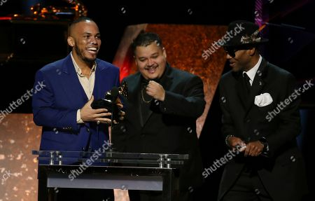 """Anderson .Paak, Jhair Lazo, Jimmy Jam. Anderson .Paak, far left, accepts the award for best R&B album for """"Ventura"""" at the 62nd annual Grammy Awards, in Los Angeles. Looking on from right are Jhair Lazo and Jimmy Jam"""