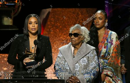 """Lauren London, Margaret Boutte, Samantha Smith. Lauren London, from left, Margaret Boutte, and Samantha Smith accept the award for best rap performance for """"Racks in the Middle"""" on behalf of Nipsey Hussle at the 62nd annual Grammy Awards, in Los Angeles"""