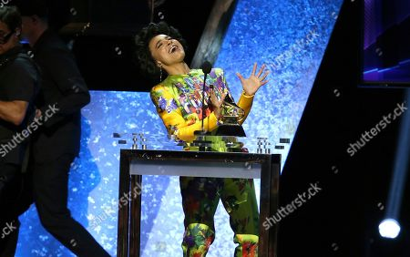 """Esperanza Spalding reacts as she accepts the award for best jazz vocal album for """"12 Little Spells"""" at the 62nd annual Grammy Awards, in Los Angeles"""