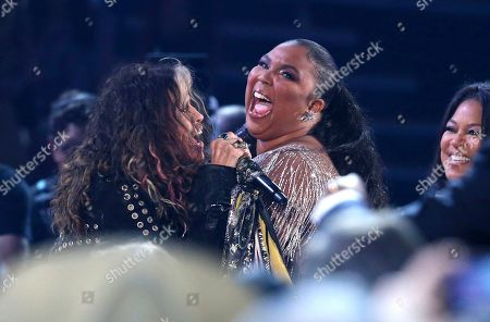 Steven Tyler, Lizzo. Steven Tyler, left, of the musical group Aerosmith, and Lizzo appear in the audience as Tyler performs at the 62nd annual Grammy Awards, in Los Angeles
