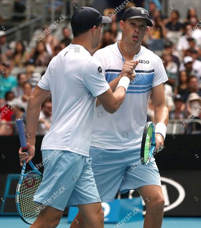 Mike Bryan, left, of the U.S. and his brother Bob react following their third round doubles loss to Croatia's Ivan Dodig and Slovakia's Filip Polasek at the Australian Open tennis championship in Melbourne, Australia