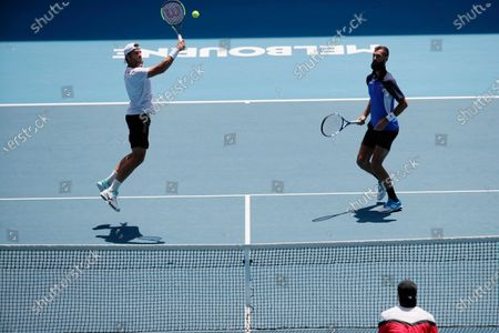 Simone Bolelli (L) of Italy and Benoit Paire (R) of France in action during their men's doubles fourth round match against Henri Kontinen of Finland and Jan-Lennard Struff of Germany at the Australian Open Grand Slam tennis tournament in Melbourne, Australia, 27 January 2020.