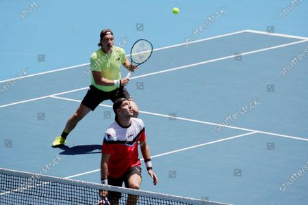 Henri Kontinen (R) of Finland and Jan-Lennard Struff (L) of Germany in action during their men's doubles fourth round match against Simone Bolelli of Italy and Benoit Paire of France at the Australian Open Grand Slam tennis tournament in Melbourne, Australia, 27 January 2020.