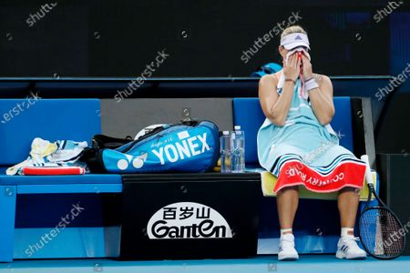Angelique Kerber of Germany covers her face with a towel during a break in her women's singles fourth round match against Anastasia Pavlyuchenkova of Russia at the Australian Open Grand Slam tennis tournament in Melbourne, Australia, 27 January 2020.