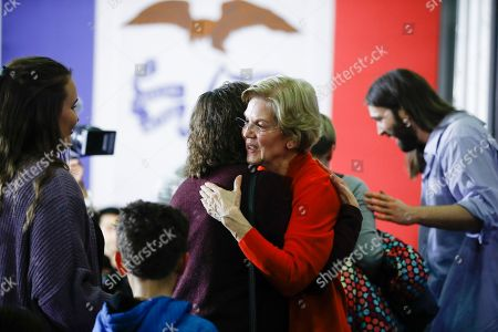 Democratic presidential candidate Sen. Elizabeth Warren, D-Mass., accompanied by Jonathan Van Ness during a campaign event, in Cedar Rapids, Iowa