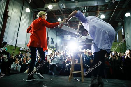 Jonathan Van Ness joins Democratic presidential candidate Sen. Elizabeth Warren, D-Mass., on stage during a campaign event, in Cedar Rapids, Iowa