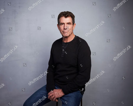 """Mark Manning poses for a portrait to promote the film """"The Cost of Silence"""" at the Music Lodge during the Sundance Film Festival, in Park City, Utah"""