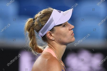 Angelique Kerber of Germany reacts after losing her fourth round match against Anastasia Pavlyuchenkova of Russia at the Australian Open tennis tournament at Melbourne Park in Melbourne, Australia, 27 January 2020.