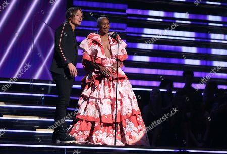 Keith Urban, Cynthia Erivo. Keith Urban, left, and Cynthia Erivo present the award for best pop solo performance at the 62nd annual Grammy Awards, in Los Angeles