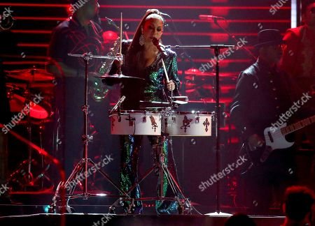 Sheila E. performs during a Prince tribute at the 62nd annual Grammy Awards, in Los Angeles