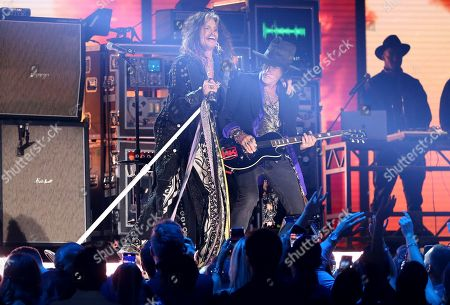 Steven Tyler, Joe Perry. Steven Tyler, left, and Joe Perry, of the musical group Aerosmith, perform at the 62nd annual Grammy Awards, in Los Angeles