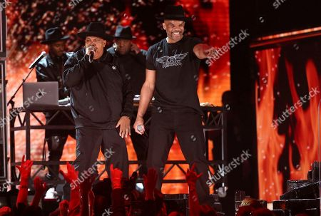 """Joseph Simmons, Darryl McDaniels. Joseph Simmons, left, and Darryl McDaniels, of Run-D.M.C., perform """"Walk this Way"""" at the 62nd annual Grammy Awards, in Los Angeles"""
