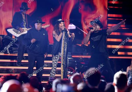 "Joseph Simmons, Darryl McDaniels, Steven Tyler, Joe Perry. Joseph Simmons, from left, Steven Tyler and Darryl McDaniels perform ""Walk this Way"" at the 62nd annual Grammy Awards, in Los Angeles. In background left is Joe Perry"