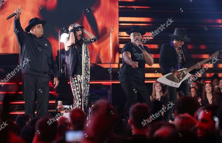 "Joseph Simmons, Darryl McDaniels, Steven Tyler, Joe Perry. Joseph Simmons, from left, Steven Tyler Darryl McDaniels and Joe Perry perform ""Walk this Way"" at the 62nd annual Grammy Awards, in Los Angeles. Photo by Matt Sayles/Invision/AP"