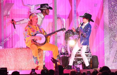 Stock Photo of Diplo, Mason Ramsey, Lil Nas X. Diplo, from left, Lil Nas X, and Mason Ramsey perform at the 62nd annual Grammy Awards, in Los Angeles