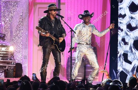 Billy Ray Cyrus, Lil Nas X. Billy Ray Cyrus, left, and Lil Nas X perform at the 62nd annual Grammy Awards, in Los Angeles