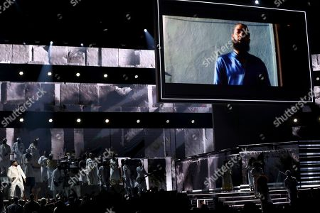 Meek Mill. DJ Khaled, left, performs during a tribute in honor of the late Nipsey Hussle at the 62nd annual Grammy Awards, in Los Angeles