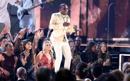 Kirk Franklin performs during a tribute in honor of the late Nipsey Hussle at the 62nd annual Grammy Awards, in Los Angeles
