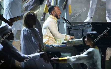 John Legend performs during a tribute in honor of the late Nipsey Hussle at the 62nd annual Grammy Awards, in Los Angeles