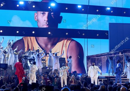 YG, John Legend, Kirk Franklin, DJ Khaled, Meek Mill. YG, from left, John Legend, Kirk Franklin, DJ Khaled and Meek Mill perform during a tribute in honor of the late Nipsey Hussle at the 62nd annual Grammy Awards, in Los Angeles