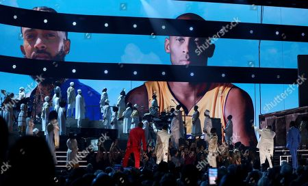 YG, John Legend, Kirk Franklin, DJ Khaled, Meek Mill. YG, from left, John Legend, Kirk Franklin, DJ Khaled and Meek Mill point to a screen showing Nipsey Hussle and Kobe Bryant during a tribute at the 62nd annual Grammy Awards, in Los Angeles