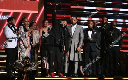 DJ Khaled, John Legend. DJ Khaled, center left, and John Legend, center right and members of Nipsey Hussle's family accept the award for best rap/sung performance at the 62nd annual Grammy Awards, in Los Angeles