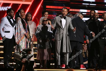 DJ Khaled, John Legend. John Legend, center, DJ Khaled and members of Nipsey Hussle's family accept the award for best rap/sung performance at the 62nd annual Grammy Awards, in Los Angeles
