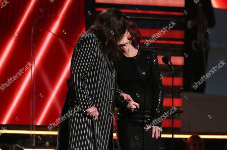 Ozzy Osbourne, Sharon Osbourne. Ozzy Osbourne, left, and Sharon Osbourne kiss on stage at the 62nd annual Grammy Awards, in Los Angeles