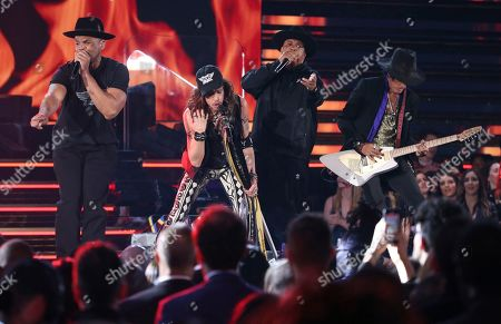 "Darryl McDaniels, Steven Tyler, Joseph Simmons, Joe Perry. Darryl McDaniels, Steven Tyler, Joseph Simmons and Joe Perry perform ""Walk this Way"" at the 62nd annual Grammy Awards, in Los Angeles. Photo by Matt Sayles/Invision/AP"