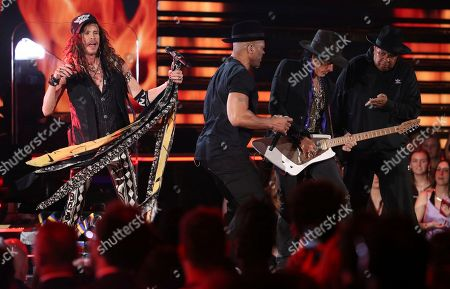 "Steven Tyler, from left, Darryl McDaniels, Joe Perry and Joseph Simmons perform ""Walk this Way"" at the 62nd annual Grammy Awards, in Los Angeles. Photo by Matt Sayles/Invision/AP"