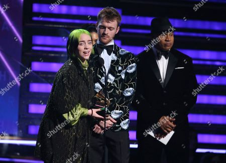 """Billie Eilish, Finneas O'Connell, LL Cool J. Billie Eilish, left, and Finneas O'Connell accept the award for album of the year for """"When We All Fall Asleep, Where Do We Go?"""" at the 62nd annual Grammy Awards, in Los Angeles. Looking on at right is presenter LL Cool J"""