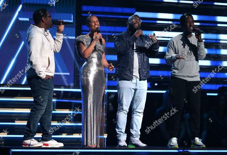 Stock Photo of Nathan Morris, Alicia Keys, Wanya Morris, Shawn Stockman. Nathan Morris, from left, Wanya Morris, Shawn Stockman, of Boyz II Men?, and Alicia Keys, second left, sing a tribute in honor of the late Kobe Bryant at the 62nd annual Grammy Awards, in Los Angeles