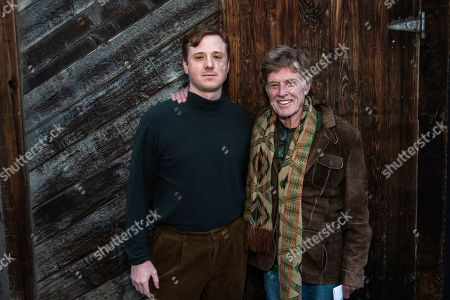 """Robert Redford, Dylan Redford. Director Dylan Redford, left, and his grandfather Robert Redford pose for a portrait to promote """"Omniboat: A Fast Boat Fantasia Barrino """" during the 2020 Sundance Film Festival, in Park City, Utah"""