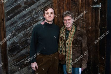 """Robert Redford, Dylan Redford. Director Dylan Redford, left, and his grandfather Robert Redford pose for a portrait to promote """"Omniboat: A Fast Boat Fantasia"""" during the 2020 Sundance Film Festival, in Park City, Utah"""