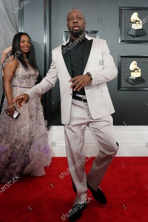 Stock Photo of Claudinette Jean and Wyclef Jean