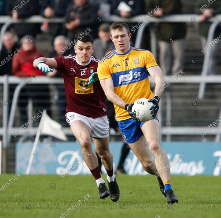 Ciaran Russell of Clare holds on to the ball under pressure from David Lynch of Westmeath