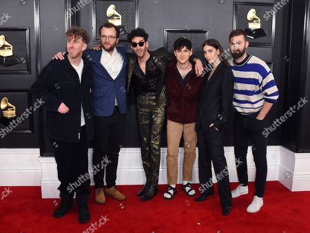 Danielle Haim, second from right, and Vampire Weekend arrive at the 62nd annual Grammy Awards at the Staples Center, in Los Angeles
