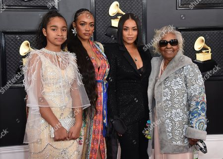 Lauren London, Margaret Boutte, Samantha Smith. The family of the late Nipsey Hussle, Emani Asghedom, from left, Samantha Smith, Lauren London and Margaret Boutte arrive at the 62nd annual Grammy Awards at the Staples Center, in Los Angeles
