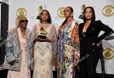 """Stock Photo of Margaret Boutte, Emani Asghedom, Samantha Smith, Lauren London. The family of the late Nipsey Hussle, Margaret Boutte, Emani Asghedom, Samantha Smith and Lauren London pose in the press room on behalf of Nipsey Hussle with the award for best rap performance for """"Racks in the Middle"""" at the 62nd annual Grammy Awards at the Staples Center, in Los Angeles"""