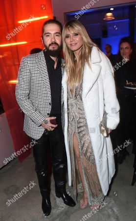 Stock Photo of Tom Kaulitz, Heidi Klum. Tom Kaulitz, left, and Heidi Klum attend Universal Music Group's 2020 Grammy After Party Presented By Lenovo on in Los Angeles