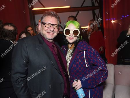 Sir Lucian Grainge, Billie Eilish. Sir Lucian Grainge, Chairman and Chief Executive Officer of Universal Music Group, left, and Billie Eilish attend Universal Music Group's 2020 Grammy After Party Presented By Lenovo on in Los Angeles