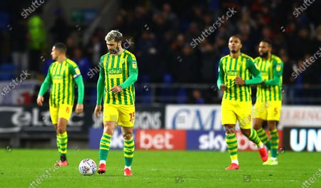 Charlie Austin of West Bromwich Albion shows a look of dejection after Lee Tomlin of Cardiff City scores a goal to make the score 2-1