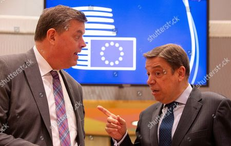 Spain's Agriculture Minister Luis Planas Puchades, right, speaks with Denmark's Agriculture Minister Mogens Jensen during a round table meeting of EU agriculture ministers at the Europa building in Brussels