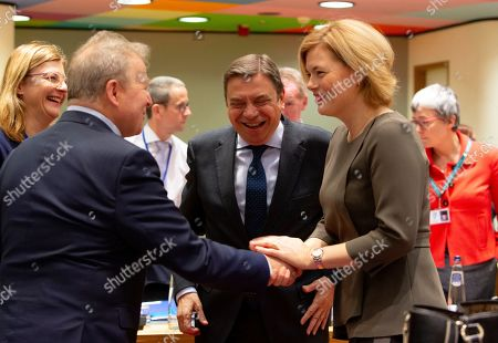 Germany's Agriculture Minister Julia Kloeckner, right, speaks with Spanish Agriculture Minister Luis Planas Puchades, center, and European Commissioner for Agriculture Janusz Wojciechowski, second left, during a round table meeting of EU agriculture ministers at the Europa building in Brussels