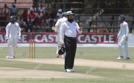 Pakistan Umpire Aleem Dar signals four runs during the test cricket match between Zimbabwe and Sri Lanka at Harare Sports Club