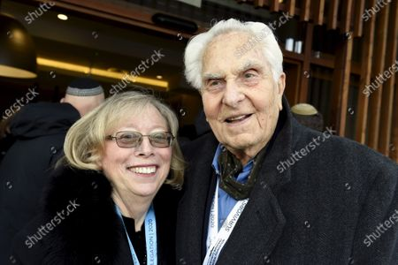 Holocaust survivor from Auschwitz concentration camp, David Marks (right) and his spouse Kathy Peck during ceremonies to commemorate the 75th anniversary of the camp's liberation in Oswiecim