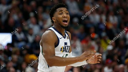 Utah Jazz guard Donovan Mitchell (45) shouts to his team in the first half during an NBA basketball game against the Dallas Mavericks, in Salt lake City