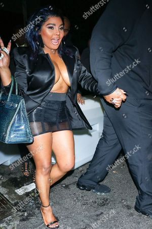 Lil Kim leaving TAO Restaurant.